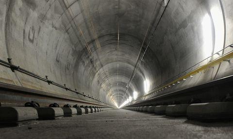 Infrastructure, Line, Ceiling, Tunnel, Fixture, Concrete, Parallel, Monochrome, Composite material, Space,