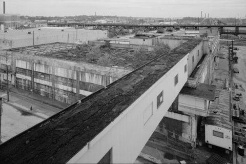 Urban area, Monochrome, Parallel, Monochrome photography, Black-and-white, Composite material, Urban design, Apartment, Steel, Railroad car,