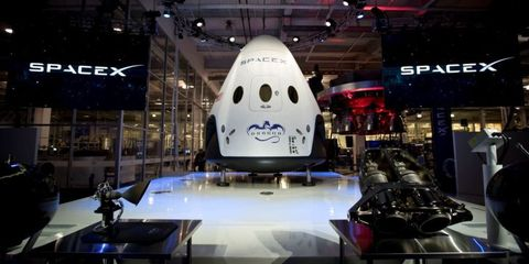 Design, Luxury vehicle, Technology, Auto show, Spacecraft, Vehicle, Space, Fictional character, Display window, Aerospace engineering,