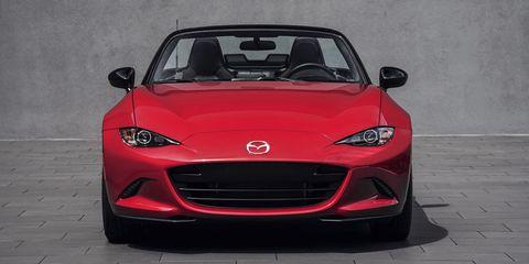 Automotive design, Vehicle, Land vehicle, Hood, Grille, Automotive mirror, Car, Red, Headlamp, Glass,