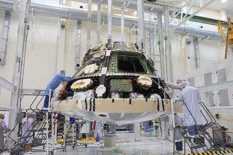 Aerospace engineering, Engineering, Space, Machine, Service, Industry, Light fixture, Science, Factory, Spacecraft,