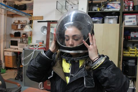 Kellie Gerardi preparing for an EVA in a prototype spacesuit loaned by Final Frontier Design, a commercial spacesuit company under Space Act Agreement with NASA's Commercial Crew Program.