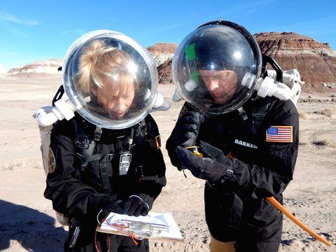 Pamela Nicoletatos and Paul Bakken conduct a geological survey of the area.
