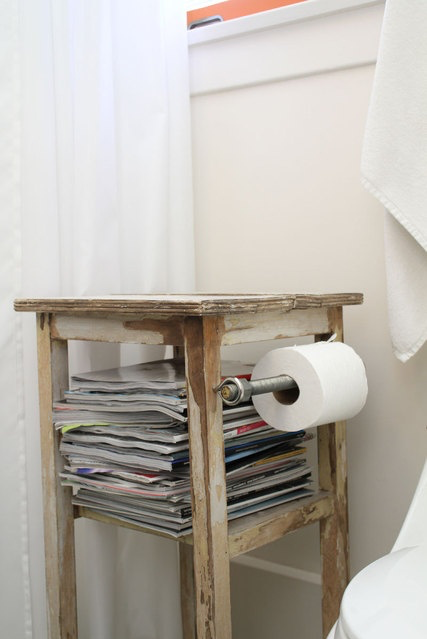 "<p>Don't have room for a toilet paper holder and a stash of reading material (don't try to hide it— we all know you're catching up on current events in there)? Simply combine them into a slim stand. </p><p><em><a href=""http://www.apartmenttherapy.com/stevens-800-square-foot-reloca-140848#_"" target=""_blank"">See more at Apartment Therapy »</a></em></p><p><a href=""http://www.apartmenttherapy.com/stevens-800-square-foot-reloca-140848#_"" target=""_blank""></a></p>"