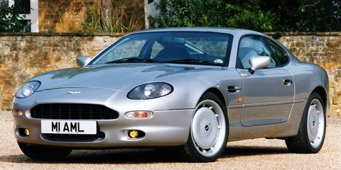 "<p>The British carmaker kept up appearances with this c<a href=""http://www.caranddriver.com/comparisons/aston-martin-db7-vantage-vs-porsche-911-turbo-ferrari-360-modena-f1-comparison-tests"">lassically proportioned coupe</a>.</p>"