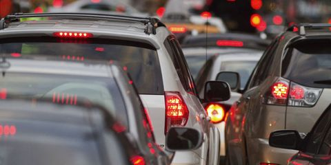 Motor vehicle, Automotive tail & brake light, Automotive lighting, Automotive exterior, Automotive mirror, Automotive parking light, Traffic congestion, Rear-view mirror, Automotive window part, Traffic,