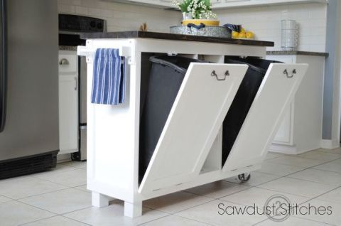 "<p>Betcha didn't realize this island used to be kitchen cabinets. Trash cans fit snugly inside on hinged doors with a hook that connects to the top to the interior cabinet — preventing your doors from falling open and spilling the trash on the floor.</p><p><a href=""http://sawdust2stitches.com/garage-sale-cabinet-into-kitchen-island/"" target=""_blank""><em>See more at Sawdust 2 Stitches »</em></a></p>"