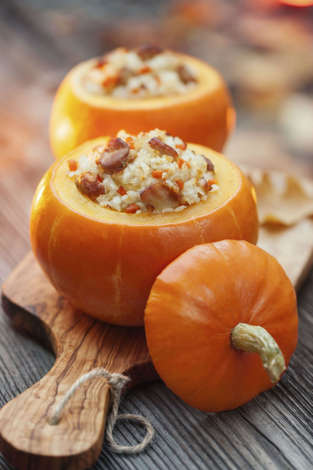 """<p>Stuff your pumpkins—and your guests—with this clever recipe that's as adorable as it  is delicious.</p><p><a href=""""http://www.countryliving.com/food-drinks/recipes/a987/baked-stuffed-pumpkin-3090/"""" target=""""_blank"""">Get the recipe</a>. </p>"""