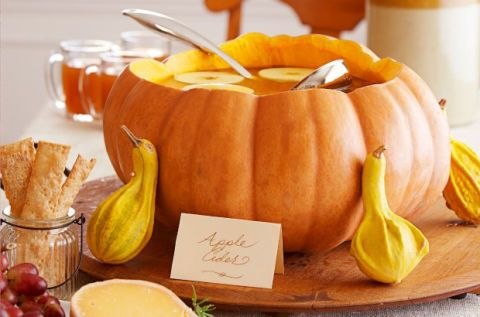 """<p>Skip the punch bowl and pour <a href=""""http://www.countryliving.com/food-drinks/g2605/cider-cocktails/"""" target=""""_blank"""">apple cider</a> inside a pumpkin instead. Not only does this idea look adorable,  the pumpkin flavor will infuse your drink with tasty fall goodness, too. </p><p><a href=""""http://www.countryliving.com/food-drinks/a36523/pumpkin-punch-bowl/"""" target=""""_blank"""">Get the tutorial</a>.</p>"""