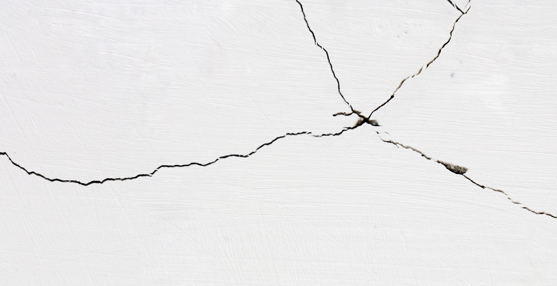 fix drywall cracks corners