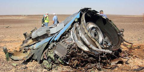 Automotive tire, Soil, Tread, Scrap, Crash, Synthetic rubber, Sand, Machine, Aeolian landform, Engine,