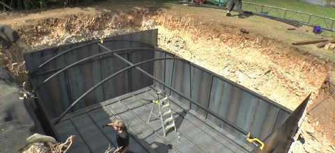 Soil, Concrete, Composite material, Iron, Building material, Daylighting, Steel, Fence,