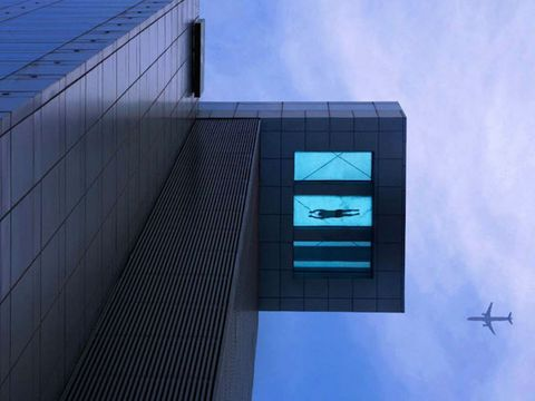 Daytime, Architecture, Commercial building, Line, Facade, Glass, Aircraft, Azure, Parallel, Aerospace engineering,