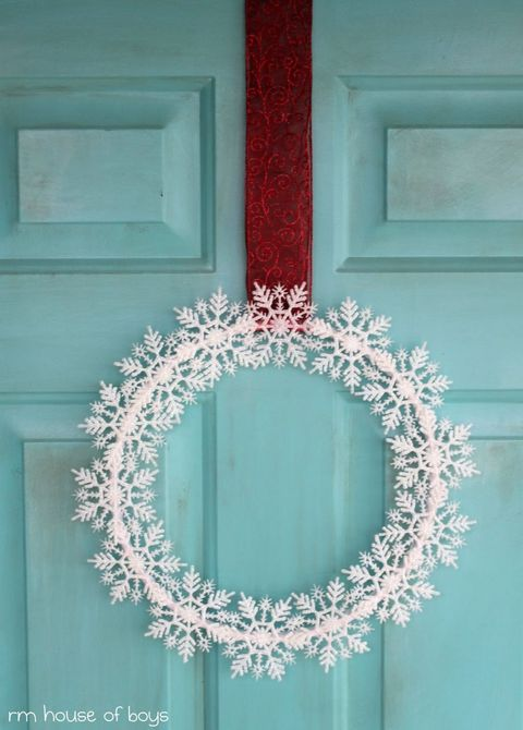 "<p>Hang this easy DIY wreath with a thick, bold ribbon. If you have a light colored door, use a dark hue for a lovely contrast. </p><p><em><a href=""http://rmhouseofnoise.blogspot.com/2011/11/snowflakes-keep-falling-on-my-head.html"" target=""_blank"">See more at Houseful of Noise »</a></em><span></span></p>"