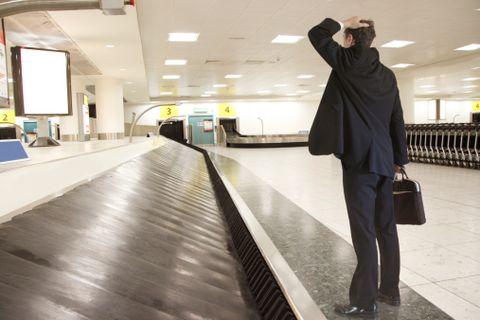 Standing, Bag, Ceiling, Luggage and bags, Travel, Street fashion, Baggage, Photography, Snapshot, Handbag,