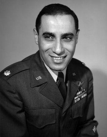 "<p>James Jabara was a United States Air Force fighter pilot in World War II, the Korean War, and the Vietnam War. In WW II, Jabara flew a <a href=""https://en.wikipedia.org/wiki/North_American_P-51_Mustang"">P-51 Mustang</a> on two combat tours and scored one-and-a-half victories (one shared victory) against German aircraft. In April 1951, during the Korean War, Jabara shot down four Soviet-built <a href=""https://en.wikipedia.org/wiki/Mikoyan-Gurevich_MiG-15"">MiG-15 jets</a> in an <a href=""https://en.wikipedia.org/wiki/North_American_F-86_Sabre"">F-86 Sabre</a> with .50 caliber machine gun fire. He voluntarily joined the 335th Fighter-Interceptor Squadron to stay in Korea when his own squadron returned to America. In May, Jabara was flying to support an aerial battle in <a href=""https://en.wikipedia.org/wiki/MiG_Alley"">MiG Alley</a>, an area of northwestern North Korea, when he tried to jettison his spare fuel tank to decrease weight and improve maneuverability, but the tank did not separate from the wing entirely. Protocol would have Jabara return to base as the maneuverability of his aircraft was compromised, but he decided to press on. Jabara successfully scored two more victories over MiG-15s despite his aircraft's disadvantage, making him the first American jet ace in history. After Korea, Jabara rose through the ranks of the Air Force to become the youngest colonel at the time. He flew with an <a href=""https://en.wikipedia.org/wiki/North_American_F-100_Super_Sabre"">F-100 Super Sabre</a> flight group in Vietnam on a bombing run that damaged buildings held by the Viet Cong. He finished his career with 16.5 total aerial victories. </p>"