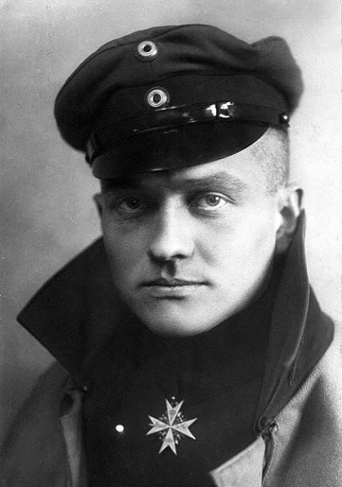 "<p>The ""Red Barron"" is perhaps the most famous flying ace of all time. Richthofen, a pilot for the Imperial German Army Air Service, had more aerial victories in World War I than any other pilot, making him the ace of aces of the war. In his red <a href=""https://en.wikipedia.org/wiki/Fokker_Dr.I"">Fokker Dr.1</a> fighter aircraft, Richthofen achieved fame all across Europe and became a national hero in Germany. He led the <a href=""https://en.wikipedia.org/wiki/Jagdstaffel_11"">Jasta 11</a> air squadron which enjoyed more success than any other squad in WWI, particularly in ""Bloody April"" of 1917 when Richthofen shot down 22 aircraft alone, four in a single day. He eventually commanded the first ""fighter wing"" formation, a combination of four different Jasta squadrons that became known as the ""<a href=""https://en.wikipedia.org/wiki/Jagdgeschwader_1_(World_War_I)"">Flying Circus</a>."" The Circus was incredibly effective at moving quickly to provide combat support across the front. In July 1917, Richthofen sustained a head wound that temporarily knocked him unconscious. He came to just in time to pull out of a spin and make a rough landing. In April 1918, Richthofen received a fatal wound near the Somme River in northern France. A significant amount of mystique surrounds the Red Barron's death, but it is most likely that a .303 bullet from a Canadian pilot in the Royal Air Force struck him in the chest. He was able to make an emergency landing but died sitting in the cockpit. Richthofen had 80 credited kills.</p>"