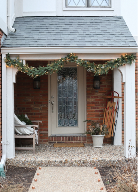 "<p>Copper tea lights and string lights are the tag team that make this porch come to life on a misty, winter day. </p><p><a href=""http://julieblanner.com/diy-copper-tealights/christmas-front-porch/"" target=""_blank""><em>See more at Julie Blanner »</em></a> </p>"