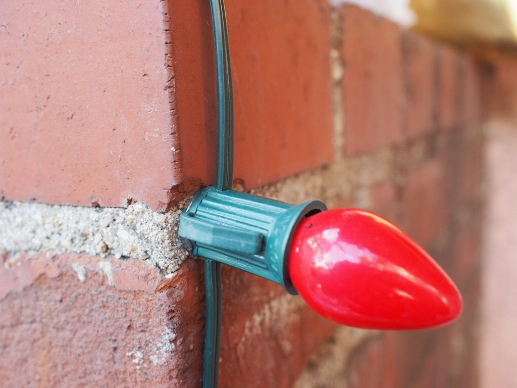 What Can I Use To Attach Christmas Lights To Brick how to use hot glue to fasten christmas lights to brick or