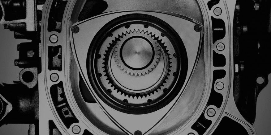 Imagine that you're a 1950s carmaker being pitched an experimental engine. This German dude named Felix walks into your office and tries to sell you on the idea of a three-pointed piston spinning around inside an oval box, burning fuel as it goes. It looks like a ball of fire in a bingo cage, or maybe a football knocking around in a washing machine. And not only does it run, but it's also incredibly balanced.