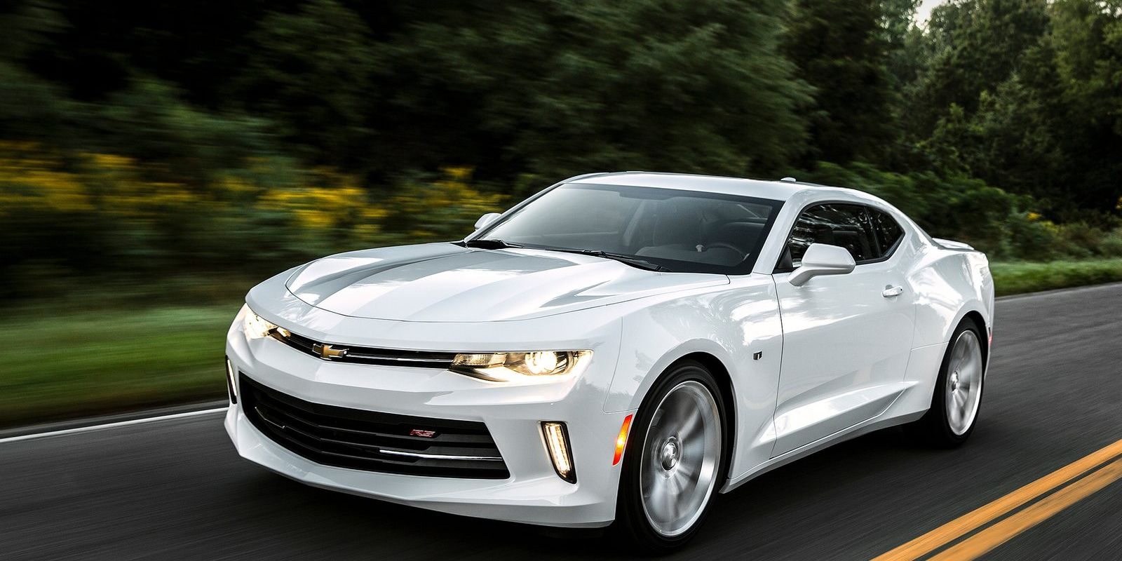 """<p>This is Chevy's first attempt at making a turbocharged four-cylinder Camaro. The 2.0-liter engine is borrowed from a Cadillac ATS and GM estimates a 0-60 sprint in under six seconds. And on highways, the <a href=""""http://www.roadandtrack.com/new-cars/news/a25749/what-you-need-to-know-about-the-new-2016-chevy-camaro/"""">Camaro should get 30 mpg</a>. When was the last time a factory Camaro could do that?</p>"""