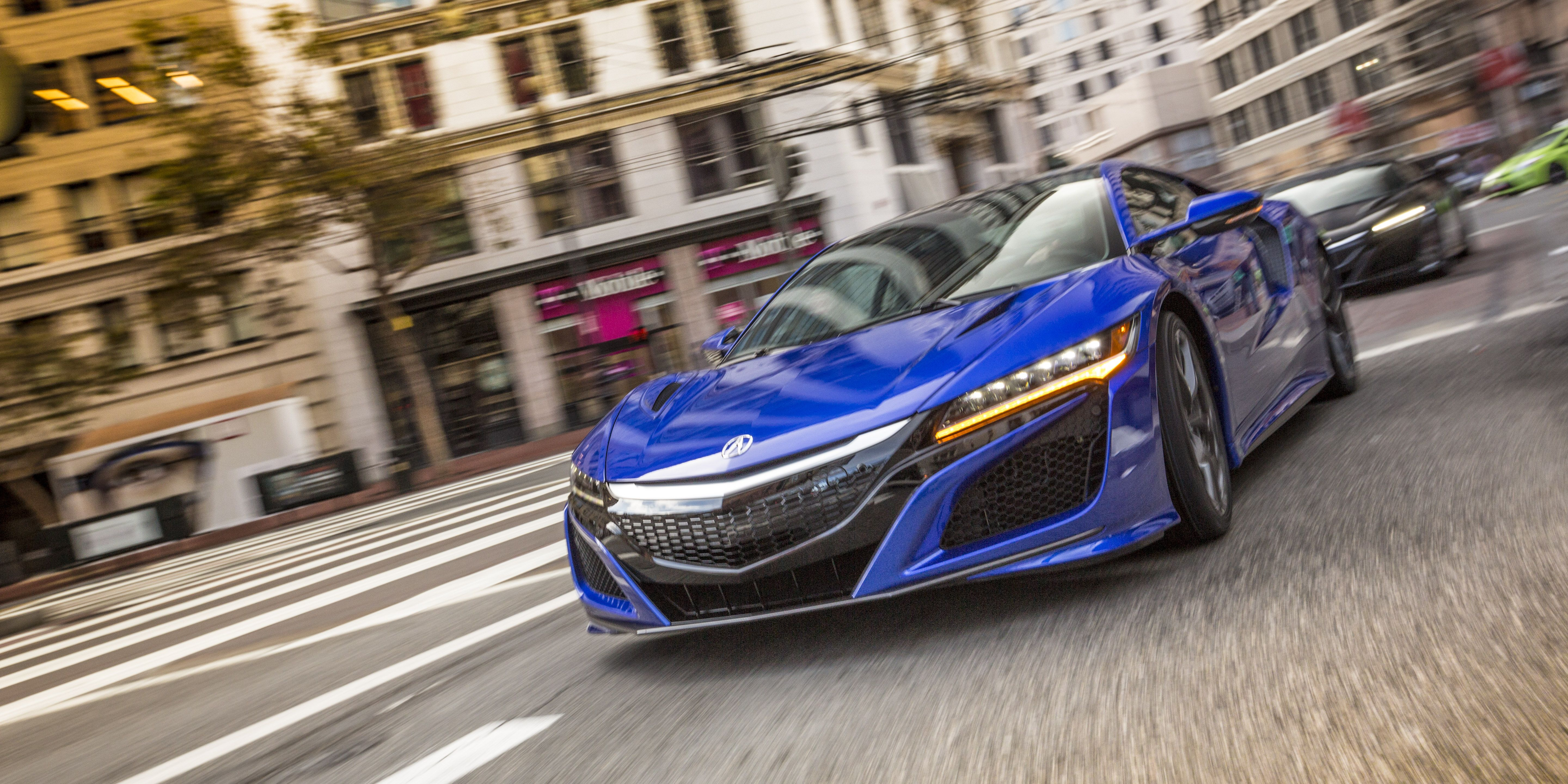 """<p>After waiting and waiting and waiting, Acura finally gives us a twin-turbo, dry-sump, 3.5-liter V6 NSX, which is far different from the naturally aspirated original and the first concept, which was also N/A. An additional three electric motors add to the engine's power, making the NSX's total power output to be 573-hp. However, in our first drive, we thought it <a href=""""http://www.roadandtrack.com/new-cars/first-drives/reviews/a27144/2017-acura-nsx-first-drive/"""">sacrificed too much in the way of livability</a>. </p>"""