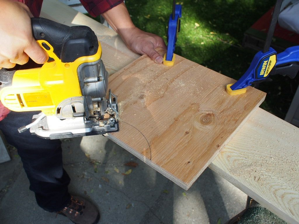 <p>Secure your long sides and front storage side to your cutting surface and use your jigsaw to carefully cut along the outline of the half circle.</p>