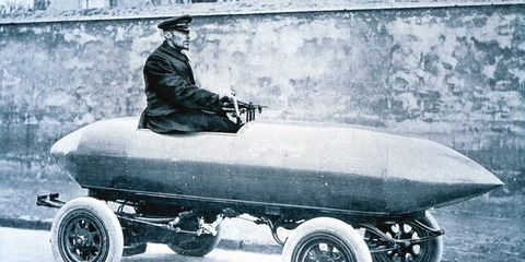 """<p>Electric cars proved their mettle in early motorsports. Belgian Camille Jenatzy, a builder of electric carriages near Paris, engaged in several speed stunts to promote his firm's engineering acumen, the highlight of which came in the spring of 1899. Driving his racing special, La Jamais Contente (""""the Never Satisfied""""), he became the first to break the 100-km/h and 60-mph barriers. A pair of direct-drive 25-kW motors, running at 200 volts drawing 124 amps each (about 67 horsepower), propelled the torpedo-shaped machine crafted from a lightweight aluminum alloy called partinium. La Jamais Contente ran on Michelin tires; the French tiremaker adopted a reproduction built in 1994 to serve as a sort of mascot for the company's Challenge Bibendum series of sustainable mobility rallies from 2004–2014.</p>"""