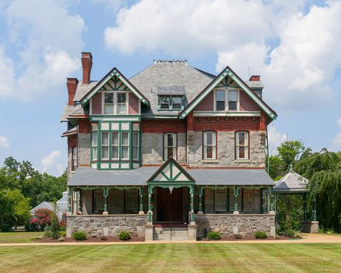 "<p><a href=""http://www.countryliving.com/real-estate/a36215/whimsical-victorian-homes-for-sale/"">More is more when it comes to Victorian homes</a>, and the Wenonah, New Jersey mansion known as Hollybush piles on the decadence in the most perfect way. All the classic Victorian flourishes are there: stained glass windows, 12-foot ceilings and intricately carved floor-to-ceiling woodwork as far as the eye can see. </p><p><strong>Asking price:</strong> $969,000</p><p>For more information, visit <a href=""http://www.foxroach.com/real_estate/nj/wenonah/201_e_mantua_ave/129-2-6679413/"">BHHS Fox & Roach, Realtors</a></p>"
