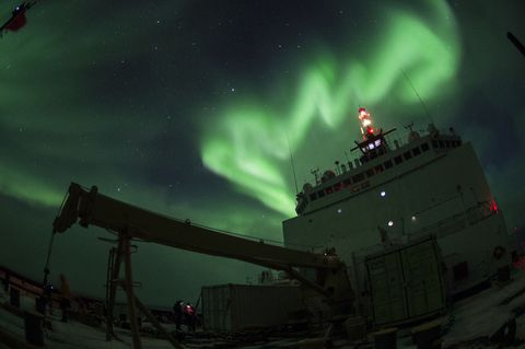 <p>Coasties enjoy a stunning view of the Aurora borealis aboard the Coast Guard Cutter Healy in the southern Arctic Ocean. </p>