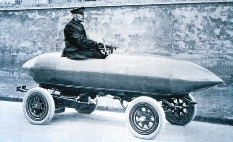 "<p>Electric cars proved their mettle in early motorsports. Belgian Camille Jenatzy, a builder of electric carriages near Paris, engaged in several speed stunts to promote his firm's engineering acumen, the highlight of which came in the spring of 1899. Driving his racing special, La Jamais Contente (""the Never Satisfied""), he became the first to break the 100-km/h and 60-mph barriers. A pair of direct-drive 25-kW motors, running at 200 volts drawing 124 amps each (about 67 horsepower), propelled the torpedo-shaped machine crafted from a lightweight aluminum alloy called partinium. La Jamais Contente ran on Michelin tires; the French tiremaker adopted a reproduction built in 1994 to serve as a sort of mascot for the company's Challenge Bibendum series of sustainable mobility rallies from 2004–2014.</p>"