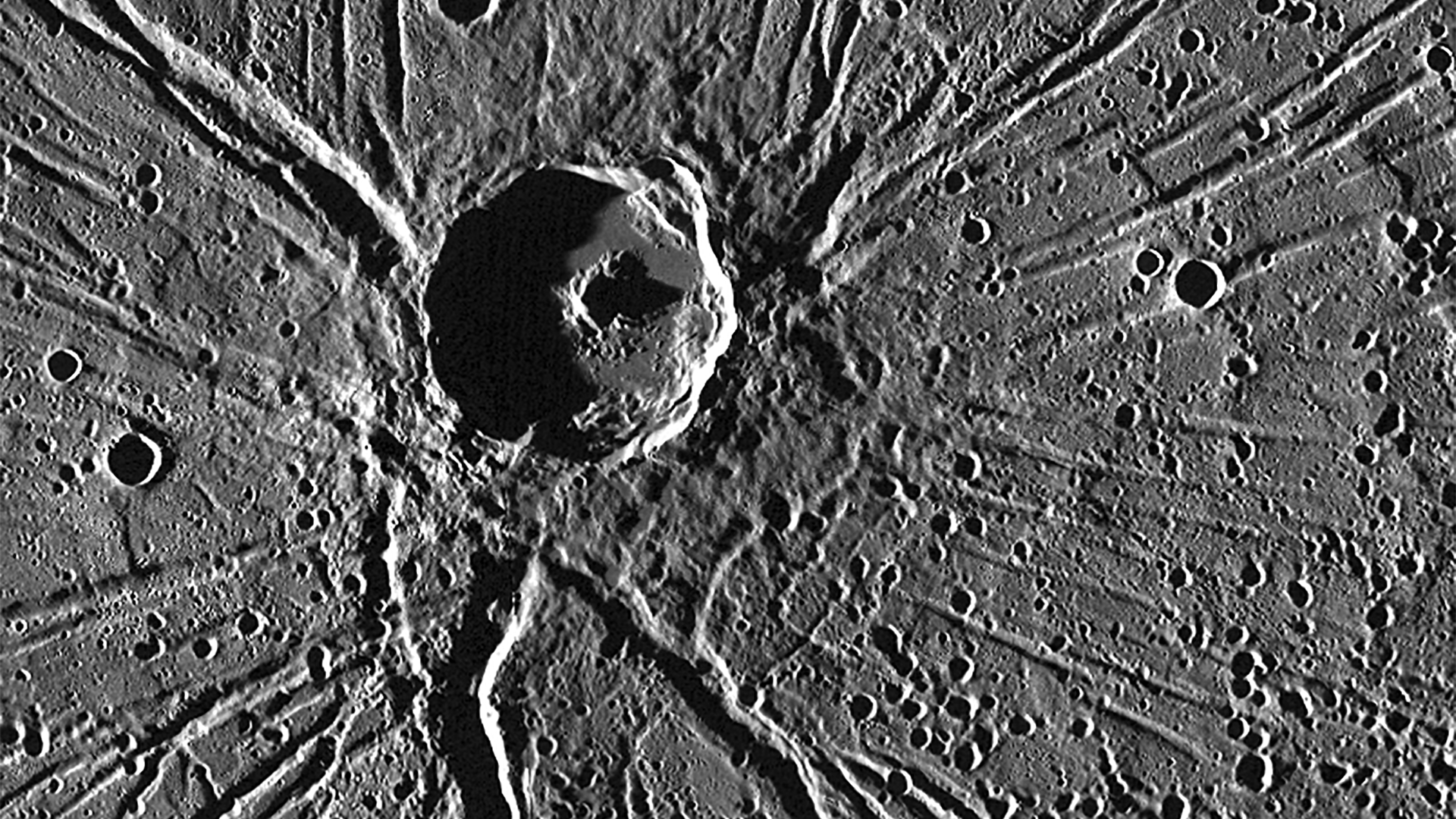 """<p>A feature on Mercury known as """"the spider,"""" the giant crater Apollodorus with the Pantheon Fossae radiating out. (<a href=""""http://photojournal.jpl.nasa.gov/catalog/PIA19410"""">Source</a>) </p>"""