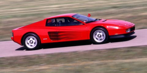 """<p>The """"redhead"""" Testarossa (one word, to distinguish from the 1950s Testa Rossa that now costs millions; see one<a href=""""http://blog.caranddriver.com/2014-pebble-beach-tour-delegance-money-on-the-move-mega-gallery/"""" target=""""_blank"""">here</a>) replaced the 512BB (Boxer Berlinetta) in 1985 and became the poster-car exotic for the late 1980s. <em>Miami Vice</em> fans know this mid-engine 380-hp extrovert as the car Ferrari gave to the TV show's producers on the condition they stop making fake ones. <br><br>Ferrari built 7000 units through 1991 when it introduced the 512TR, really an evolution of the car most notable for lowering the flat-12 engine in the chassis to improve handling, and then the 512M (for <em>modificata</em>) with less weight, more power, and fixed headlamps in place of the pop-up ones. Prices on these later 512 versions have been soaring of late—they're faster, better cars with the same look. The older, original Testarossas, though, those built when Enzo Ferrari himself still occupied the house/office adjacent to the Fiorano test track, have yet to realize those momentous gains. <br><br>An average-condition car can still be had for $110,000 to $120,000, while a top-flight example commands another $20,000 to $25,000. They're gaining value but on a more gradual upward slope than the 512TR and M have in the past year.</p>"""