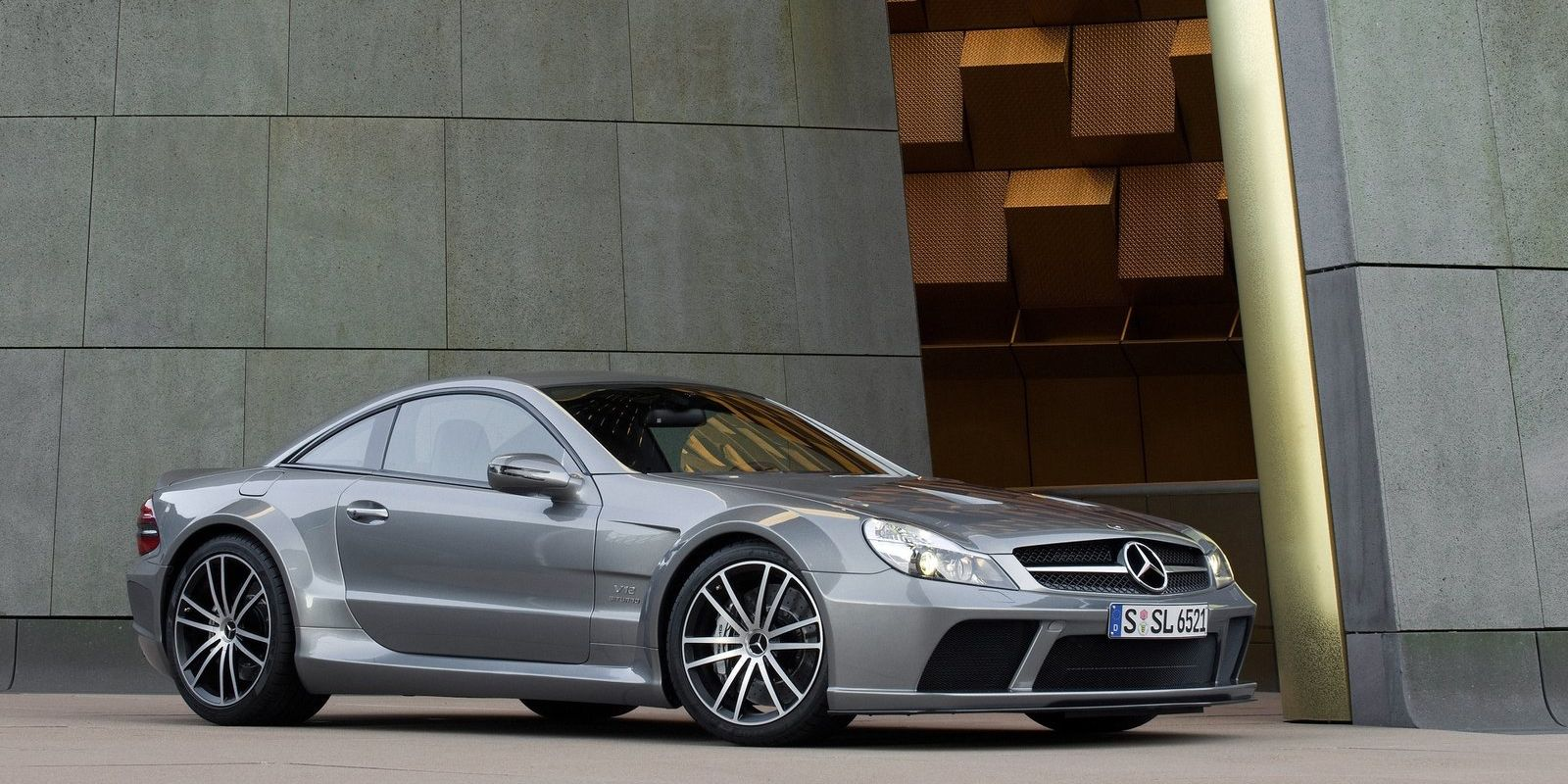 """<p>It was $300,000 when new, but the SL65 AMG Black Series also <a href=""""http://www.roadandtrack.com/new-cars/reviews/a14493/2009-mercedes-benz-sl65-amg-black-series-2/"""">had a twin-turbocharged V12</a> that made 661-hp and an earth-shattering 738 lb-ft of torque. And this car was the epitome of aggressive. It had ridiculously large front air intakes and fenders so wide you could sit on them. It was an ultimate rear-tire slayer. This is the muscle you'd hire to intimidate someone.</p>"""