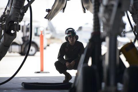 Helmet, Goggles, Aircraft, Video camera, Winter sport, Workwear, Crew, Military aircraft, Training, Ski helmet,