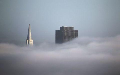 Blue, Daytime, Atmosphere, Tower block, Atmospheric phenomenon, Property, Architecture, Urban area, Facade, Photograph,
