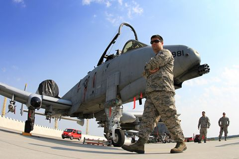 Airplane, Aircraft, Mode of transport, Soldier, Automotive tire, Aviation, Military aircraft, Military uniform, Military organization, Military,