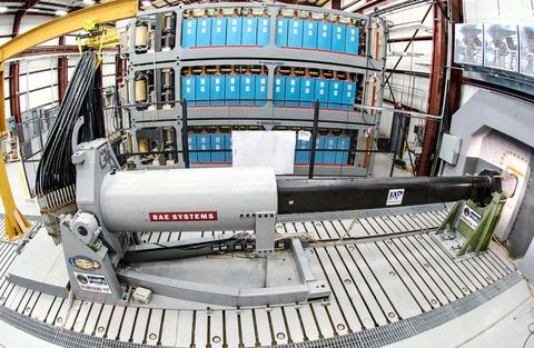 <p> The Navy's electromagnetic railgun, which accelerates a projectile to 5,000 mph in 0.01 seconds using a simple (and enormous) charge, requires no explosives and only one man to load and fire. It's been in production since 2005 and should be completed by 2017. A few more facts: </p><p>• Each projectile is 18 inches long and weighs 23 pounds.</p><p>• The cost to fire a projectile is approximately $25,000—as much as 60 times less than traditional artillery. </p><p>• After storing up a charge,the gun releases 1,200 volts in 10 milliseconds.</p><p>• Firing distance exceeds 100 miles.</p><p>• In tests the projectiles were able to pierce three walls of reinforced concrete or six steel plates.</p><p><br></p>