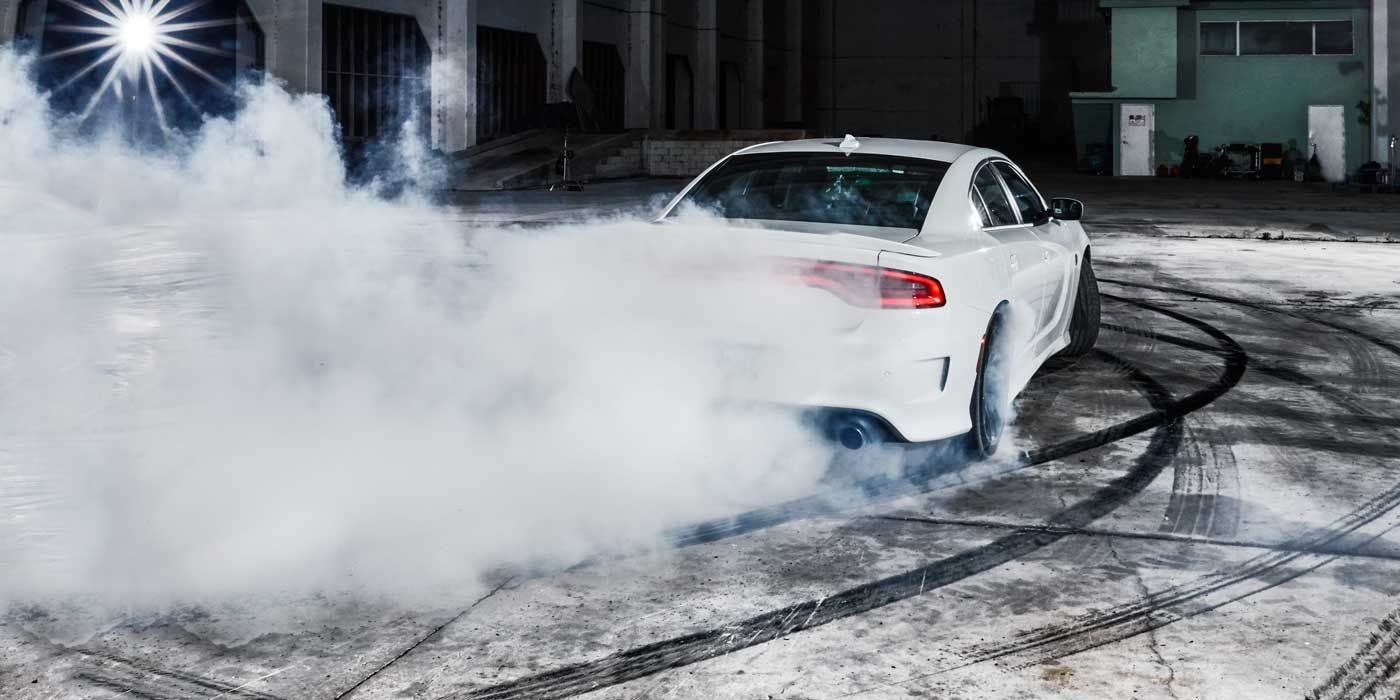 "<p>The Dodge Charger SRT Hellcat is the highest expression of America's muscle-bound past. It's a V-8, it's rear-wheel-drive, and it's certifiably huge—elements that ought to trigger nostalgia. But in its outsize ambitions, the Hellcat is something new. From the bones of a sub-$30,000 fleet car, Chrysler builds a projectile that tops out at 204 mph. Last year Jeff Gordon qualified at pole position for the Daytona 500 with a speed of 201 mph.</p><p>The Hellcat has strong brakes and decent suspension, but those components come across as afterthoughts compared with the effort that went into the engine, a supercharged 6.2-liter V8 that makes 707 horsepower. That V8 is the Hellcat's defining feature, all thunderous exhaust and <em>Mad Max</em> supercharger whine, the centerpiece of the world's most powerful internal-combustion sedan. Perhaps as a joke, or a taunt to fellow carmakers, the Hellcat comes with two keys: a red one that unleashes full power, and a black one that's ostensibly for valets and newbie drivers. With the latter key, in safety mode, the Hellcat is limited to about 500 horsepower. You know, just three Miatas' worth. Sensible. </p><p><iframe width=""500"" height=""281"" src=""//www.youtube.com/embed/ZKE535zlsl8"" frameborder=""0"" allowfullscreen=""""></iframe><br></p>"