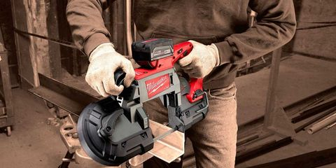 Sleeve, Machine, Saw, Workwear, Tradesman, Glove, Safety glove, Pocket, Concrete saw, Iron,