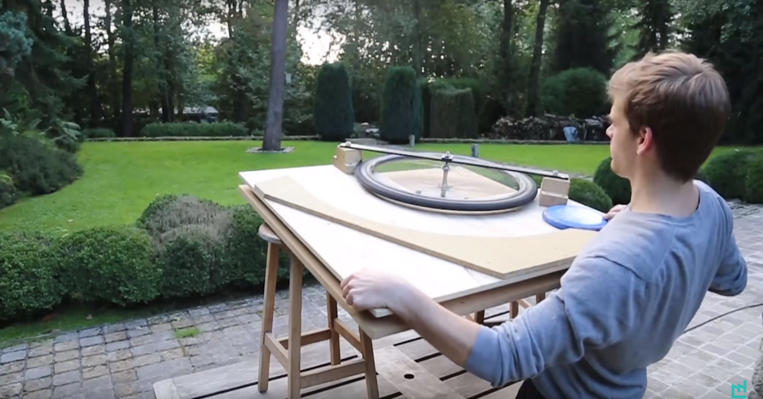 throw frisbees with an old drill and beat up bike wheel