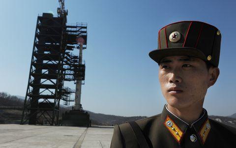 Collar, Cap, Uniform, Military uniform, Headgear, Military person, Soldier, Government agency, Law enforcement, Official,