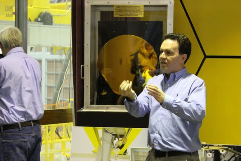 "<p>Work on the James Webb Space Telescope began in 1996, not too many years after the launch of Hubble. But that's the thing: NASA has to think that far ahead, whether it's to develop new technologies, to test out the feasibility of ideas, or simply to gather the political support behind its big, ambitious projects.</p><p>After a number of other plans came and went (including one that would have seen the telescope placed beyond the orbit of Mars to the outskirts of the asteroid belt), but the final design arrived in 2010. By 2011, the first tests had begun. Just last week, the final segment of the primary mirror was installed, paving the way for the whole craft to come together in time for its 2018 launch.</p><p>The mirrors are made out of berylium, a lightweight metal. Each mirror has separate actuators to control its movements, and the surface of the primary mirror reflects to the secondary mirror, located at the end of the long booms visible in the photo below.</p><p>""We had to make it lighter in order for the rocket to bring it up,"" Lee Feinberg, JWST optical telescope element manager, said. Each of those mirrors weighs 21 kilograms, which is 10 times lighter than the 2.5 meter primary mirror on Hubble. After their initial fabrication, the mirrors were shaved until 92 percent of the beryllium was turned back into dust and sent back for reuse.</p><p>The mirrors are the light gathering eyes for the telescope, but it's up to four instruments under the hood to make use of what those eyes see. Located in the midst of the primary mirror, the Near InfraRed Camera, Near InfraRed Spetragraph, Mid-Infrared Instrument, and Near Infrared Imager and Slitless Spectrograph will watch the skies in different wavelengths.</p><p>By studying in and around the infrared spectrum, the telescope will be able to spot hotter objects, as well as see to a <a href=""https://en.wikipedia.org/wiki/Redshift"">redshift</a> of 15. The higher the redshift, the more distant an object is.</p><p>For instance, the ""Sombrero Galaxy"" is 28 million light years from us, and has a redshift of about 0.004. The most distant galaxy ever found, EGSY8p7, has a redshift of 8.68, and is 13.2 billion light years away. With a 14 billion year old universe, that sort of power will make Webb see, essentially, to the boundary of visible time and space.</p><p><span class=""redactor-invisible-space"" style=""line-height: 1.6em; background-color: initial;""></span></p>"