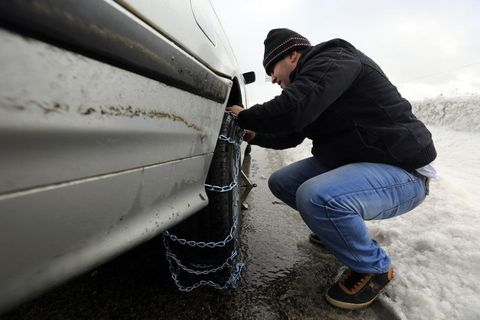 """<p>Many states don't require passenger vehicles to use chains for winter driving. And generally, our experts agree that winter tires outperform chains on most surfaces. But in some states, where the majority of the residents live in a dry hot climate, you might need to carry chains into the mountains—even if you have mud and snow rated truck tires or even proper winter tires. """"Most people wait until the last possible minute to chain up,"""" says Debogorski. """"I get it, they're inconvenient. But if you see people stuck or spinning their tires, put on your chains."""" He admits that even he was resistant to putting them on in his younger days. He says, """"They'd tell us to chain up and I wouldn't. I made it up the mountain because the guys using the chains would chew up the snow and give me the traction, not because I was the better driver."""" He advises winter drivers to use a designated safe area, like an official vehicle chain-up area to install your chains. But be sure to practice putting them on in your driveway once or twice—so the process will be smooth and easy in the field. Foust cautions against cheap chains that don't cover the whole tread in an """"X"""" or """"Z"""" pattern. """"If the chains are the type that only go across the tread linearly, they have a tendency to skate sideways across the road,"""" says Foust. """"I've seen cars literally track on ice sideways at a near dead stop because they were skating on the chains."""" </p>"""