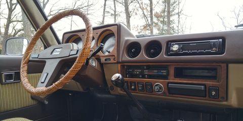 Motor vehicle, Steering part, Steering wheel, Classic car, Center console, Vehicle door, Vehicle audio, Classic, Antique car, Radio,