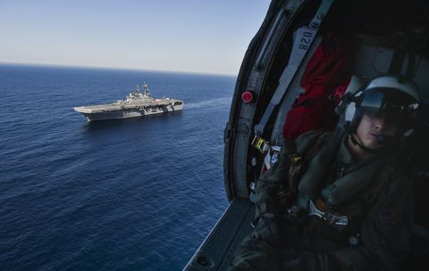 Military person, Soldier, Naval ship, Watercraft, Horizon, Marines, Personal protective equipment, Aircraft carrier, Boat, Naval architecture,