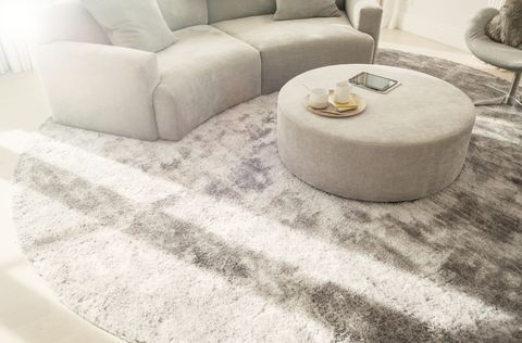 """<p>Footsteps echo extra loud on uncovered floors, so consider carpeting your floors to stop foot traffic from becoming a nuisance, <a href=""""http://www.6sqft.com/7-tips-for-soundproofing-a-noisy-apartment/?utm_source=feedly&utm_medium=webfeeds"""" target=""""_blank"""">6sqft.com</a> suggests. If you're not ready to fully commit to carpet though, a few <a href=""""http://www.elledecor.com/design-decorate/room-ideas/a7722/how-to-decorate-around-a-rug/"""" target=""""_blank"""">well-placed rugs</a> will also do the trick.<br></p>"""
