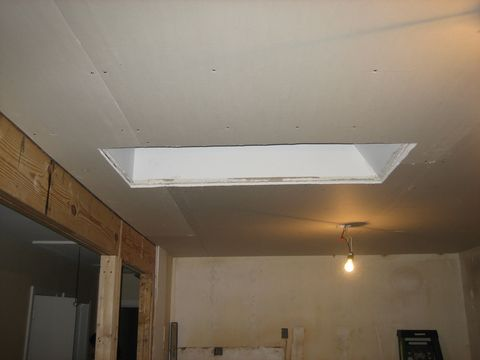 <p>Create less mess and work later by scoring the area between the wall that you are tearing down and the ceiling. This will prevent the sheetrock that you are removing from the wall taking down pieces of the ceiling with it.</p>