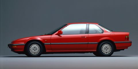 """<p>The 1987 Honda Prelude shared design cues from the NSX that came after it and is<em> </em>arguably <a href=""""http://www.nytimes.com/1987/08/30/sports/about-cars-honda-is-first-on-the-block-to-flaunt-4-wheel-steering.html"""" target=""""_blank"""">the first mass-produced car to offer four-wheel steering</a>. Are you a fan of how <a href=""""http://www.roadandtrack.com/new-cars/reviews/a6921/2014-porsche-911-turbo-s-65-7-roa0314/"""">the Porsche Turbo</a>, GT3, and <a href=""""http://www.roadandtrack.com/new-cars/first-drives/reviews/a6138/2015-porsche-918-spyder-first-drive/"""">918 Spyder</a> have it? Well, Honda had Porsche beaten by almost 25 years in offering the technology in a road car. </p>"""