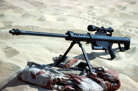 Gun, Machine gun, Shooting, Sand, Air gun, Trigger, Gun barrel, Automotive carrying rack, Shotgun, Gun accessory,